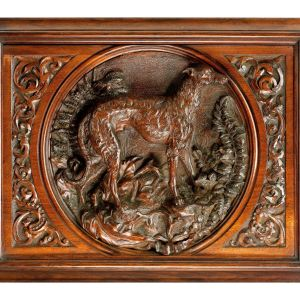 ANTIQUE CARVED WALNUT PORTRAIT OF A SCOTTISH DEERHOUND
