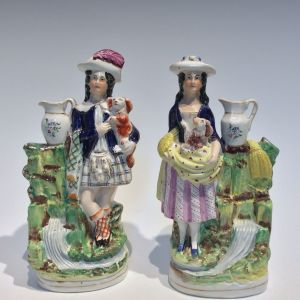 ANTIQUE PAIR STAFFORDSHIRE FIGURES MAN WOMAN DOGS