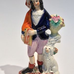 ANTIQUE STAFFORDSHIRE FIGURE OF MAN WITH DOG