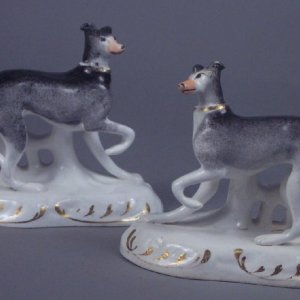 ANTIQUE STAFFORDSHIRE FIGURES OF STANDING WHIPPETS