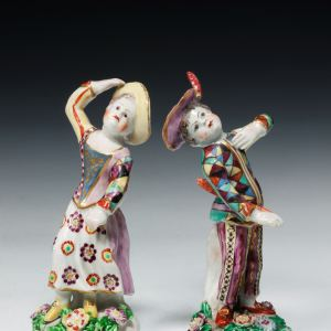 ANTIQUE PAIR BOW PORCELAIN FIGURES ARLECCHINO AND COLUMBIA