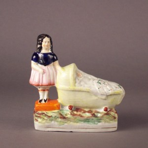 ANTIQUE STAFFORDSHIRE FIGURE OF GIRL BY CRADLE