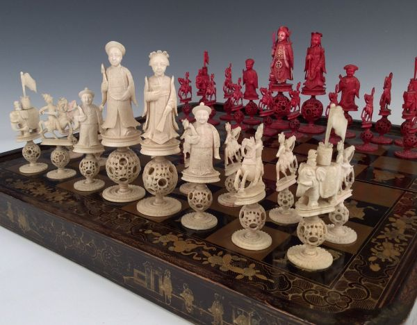 ANTIQUE CHINESE LACQUER BOARD AND IVORY CHESS SET