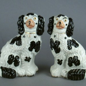 ANTIQUE STAFFORDSHIRE FIGURES OF BLACK & WHITE SPANIELS