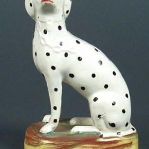 ANTIQUE STAFFORDSHIRE FIGURE OF A SEATED DALMATIAN DOG