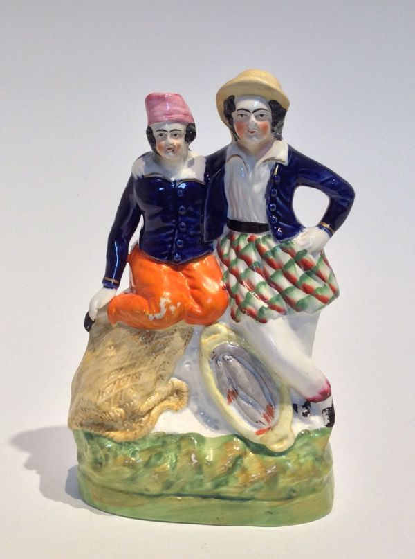 PAIR ANTIQUE STAFFORDSHIRE FIGURES OF FISHER BOYS