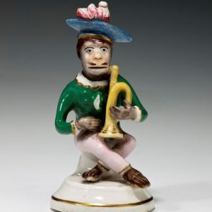 ANTIQUE STAFFORDSHIRE MONKEY BAND FIGURE