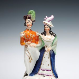 ANTIQUE STAFFORDSHIRE FIGURE OF SOLDIER AND LADY