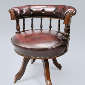 ANTIQUE LEATHER COVERED MAHOGANY REVOLVING DESK CHAIR