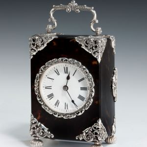 ANTIQUE TORTOISESHELL AND SILVER STRIKING CARRIAGE CLOCK