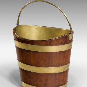 ANTIQUE MAHOGANY BRASS BOUND BOAT SHAPED BUCKET