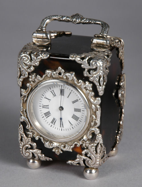 ANTIQUE SILVER AND TORTOISESHELL CARRIAGE CLOCK