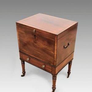 ANTIQUE REGENCY MAHOGANY CELLARET BOX ON LEGS