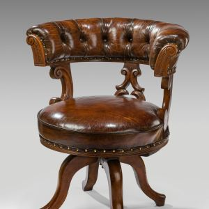 ANTIQUE LEATHER COVERED OAK SWIVEL DESK CHAIR