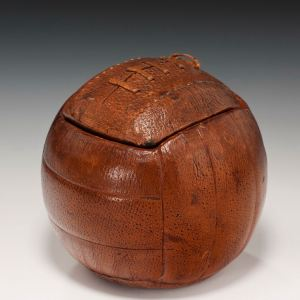ANTIQUE LEATHER FOOTBALL DESK STAND