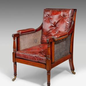 ANTIQUE MAHOGANY & CANED BERGERE LIBRARY CHAIR