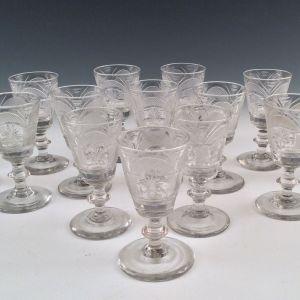 ANTIQUE SET OF FOURTEEN IRISH SHERRY GLASSES