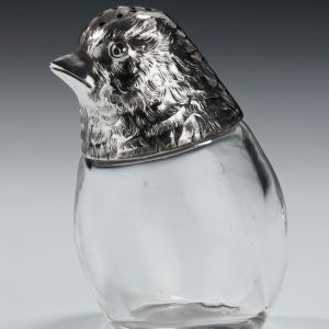 ANTIQUE SILVER AND GLASS BIRD PEPPER POT