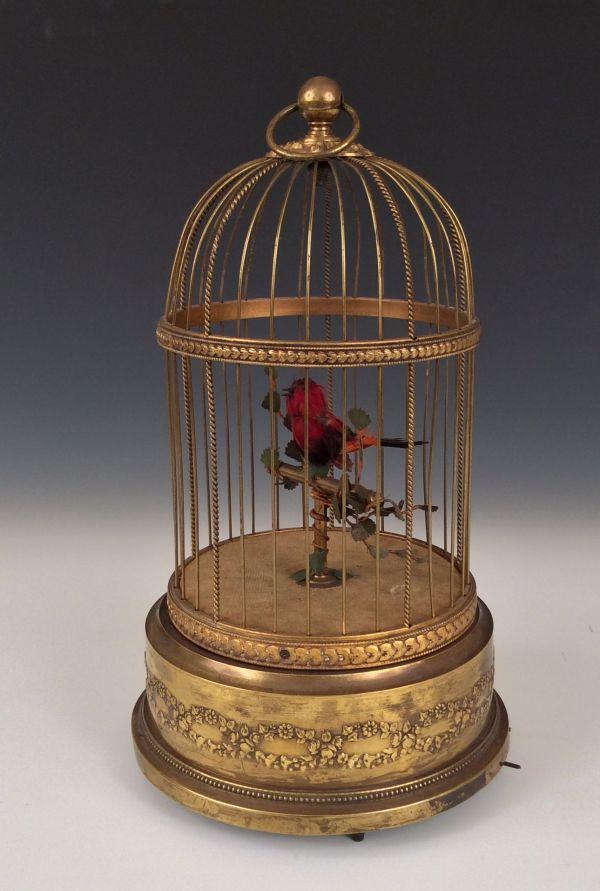 ANTIQUE SINGING BIRD IN CAGE