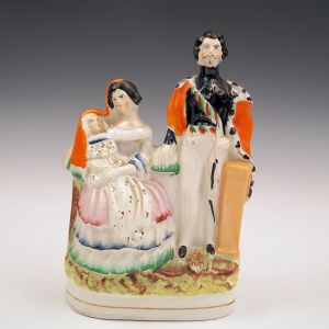 ANTIQUE STAFFORDSHIRE FIGURE OF VICTORIA ALBERT AND CHILD