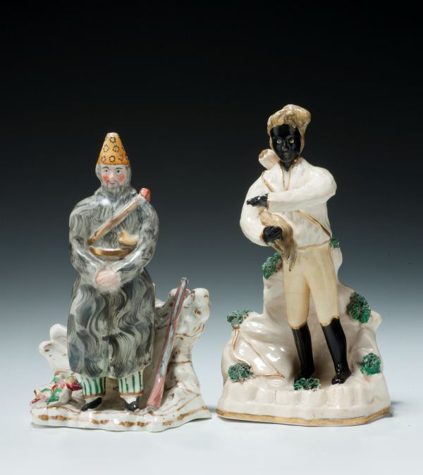 ANTIQUE STAFFORDSHIRE FIGURES OF ROBINSON CRUSOE AND MAN FRIDAY