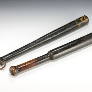 TWO ANTIQUE TURNED WOODEN TRUNCHEONS