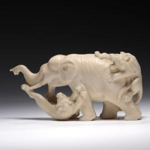 JAPANESE IVORY OKIMONO OF AN ELEPHANT AND TWO LIONS