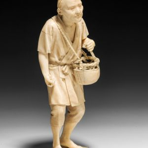 ANTIQUE JAPANESE IVORY OKIMONO OF AN ELDERLY FARMER