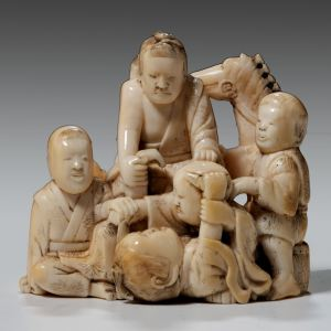JAPANESE IVORY OKIMONO OF ADULTS AND CHILDREN