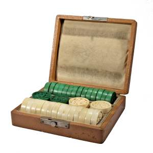 ANTIQUE BOXED SET OF CHINESE CARVED IVORY COUNTERS