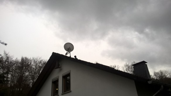 The dish installation on the roof, plus frightful looking weather.