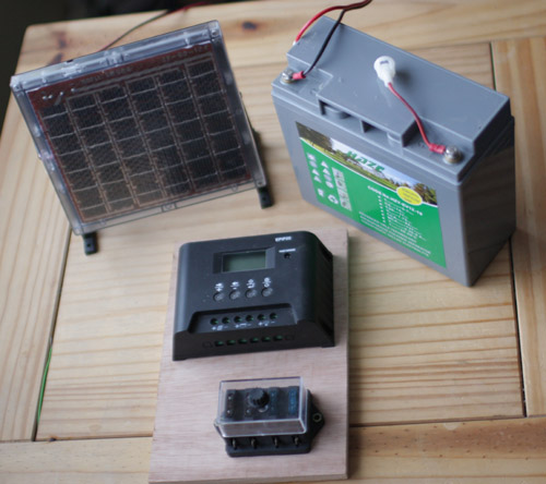 solar panel, battery, charge controller and fuse board