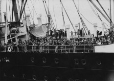 Jewish refugees arrive on MS St. Louis in 1939 after a month at sea, during which they were denied entry to Cuba, the U.S. and Canada. The ship carried 937 German-Jews fleeing Nazi persecution. (Photo Three Lions/Hulton Archive/Getty Images)