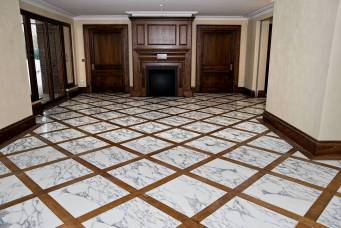 Marble flooring with wood inlay
