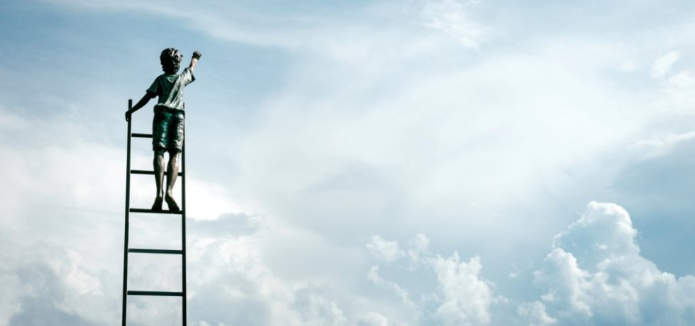 Image of child climbing a ladder to the sky representing radical generosity