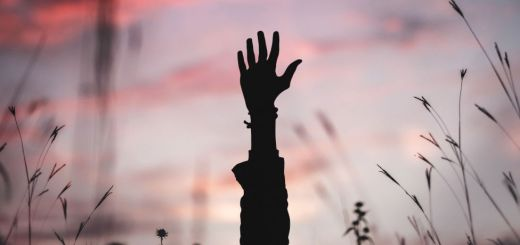 Photo of a hand in the air representing the prosperity gospel