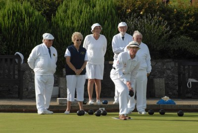 old people playing bowls on a green in lyme regis-13