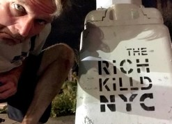 "Rich next to grafitti reading, ""The Rich Killed NYC"""