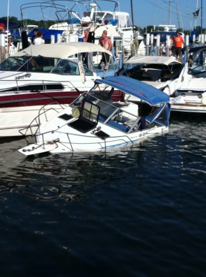 If you're going to sink, a marina's as good a place as any, I guess.