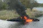 The burning boat came to rest at the mouth of the Far Mill River, near Sikorsky Aircraft. Photo from the Shelton Herald.