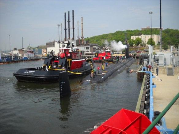 Pushing the sub into port.