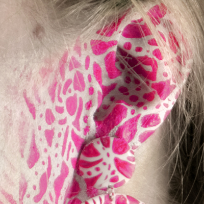Detail of photo called Primordium I. With a woman wearing earring covered with hand painted pink particles, made by Veerle Ritstier