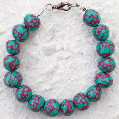 Hand crafted magenta and mint green painted bracelet called Particles III, made by Veerle Ritstier