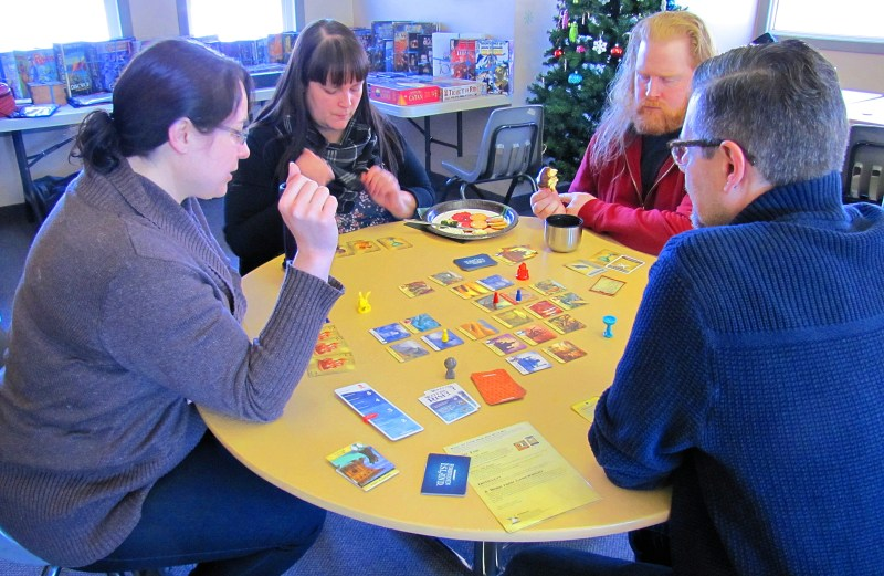 Lindsey, Tania, Chris, and Michael, also playing Forbidden Island.