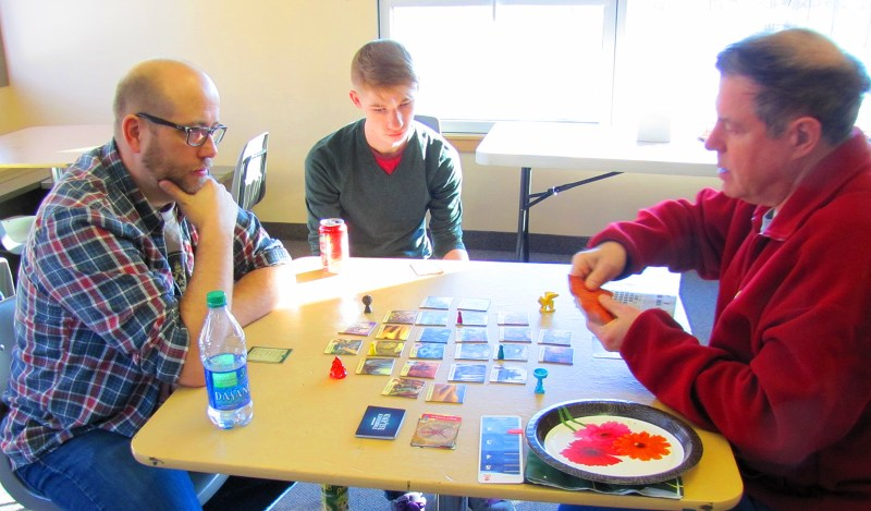 Paul, Steven, and Frederic playing Forbidden Island.