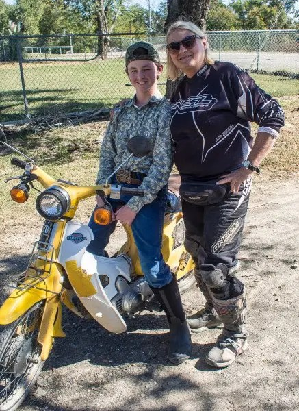 Connie Hamilton makes friends with our Honda C-70 visitor.