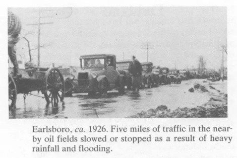 Ealrsboro, 1926. Five miles of traffic in the nearby oil fields slowed or stopped as a result of heavy rainfall and flooding.