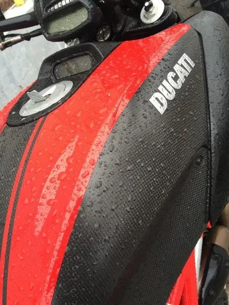 A Duc in the rain. This Ducati Diablo was sitting outside on a cold, rainy February day. Poor Duc.