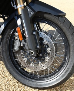 Saxess-made aluminum wheels have steel spokes laced through a center ridge that allows use of tubeless tires.