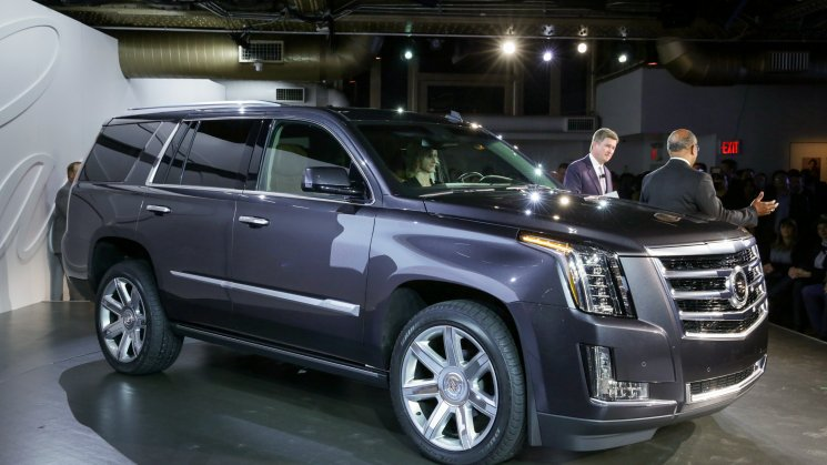 Senior Vice President Global Cadillac Bob Ferguson (left) and General Motors Vice President Global Design Ed Welburn unveil the 2015 Cadillac Escalade Monday, October 7, 2013 in New York, New York. The fourth-generation Escalade offers an entirely new design featuring new benchmarks for hand-tailored craftsmanship and technology. Production of the 2015 Escalade begins next spring with 2WD and 4WD drivetrains, and a new more powerful and more efficient 6.2L V-8 engine. (Cadillac News Photo)